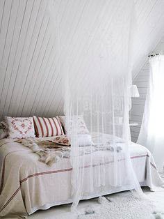 hanging this simple sheer piece at the end of the bed instantly amps up the style...nice