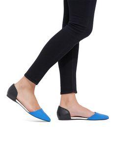 Comfy blue & black slip-on flats.