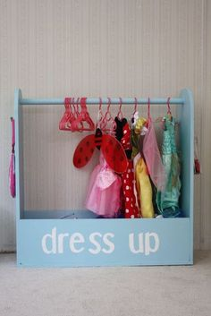 Cute dress up clothes organization. I think I may try this with a board and coat hooks across the top to make it easier for my little one to hang up her stuff.