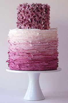 Ruffles in gradient shades of pink and hundreds of tiny pink flowers give this wedding cake an incredibly lush look. #WeddingCake