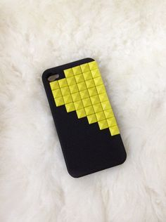 Studded black iphone 4/4S case with yellow pyramid studs. via Etsy.  http://rover.ebay.com/rover/1/710-53481-19255-0/1?ff3=4&pub=5575067380&toolid=10001&campid=5337420657&customid=&mpre=http%3A%2F%2Fwww.ebay.co.uk%2Fsch%2Fi.html%3F_sacat%3D0%26_from%3DR40%26_nkw%3Diphone%2B4%26rt%3Dnc%26LH_BIN%3D1