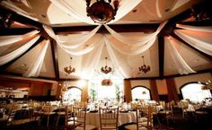 sashes strung from the beams - a great way to soften any rustic venue and add a layer of elegance  pictured: Saratoga National Golf Club, Saratoga Springs