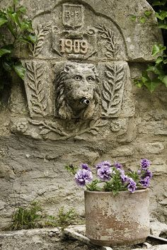 Fountain and flowers in a French village.