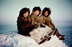 Chilling with Eskimos - Q: What do Eskimos get from sitting on a block of ice?