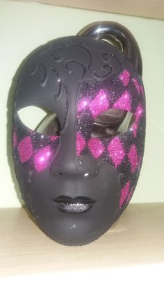 Black Clay Halloween mask with pink glitter.