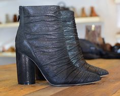 High-heeled suede booties with a slight over-wash of silver - by Sigerson Morrison.
