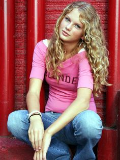 Taylor Swift.    Her shirt informs that she is BLONDE.