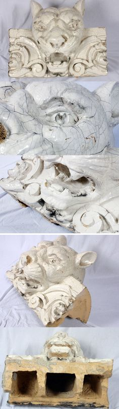 """Terra Cotta Architectural Cornice Lion Head Sculpture        Estimate: $250 - $500 Realized: $375  Authentic glazed terra cotta lion head architectural cornice piece. 20""""H x 24""""W x 19""""D. Loss to one side of nose, see photos. Reportedly from Indianapolis building."""
