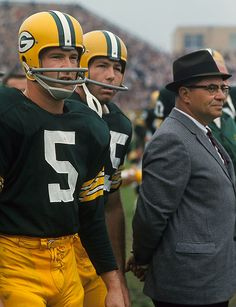 Green Bay Packers Paul Hornung, Bart Starr and Vince Lombardi look on from the sidelines during a game against the Baltimore Colts on Sept. 20, 1964 at City Stadium in Green Bay. Hornung, the first...