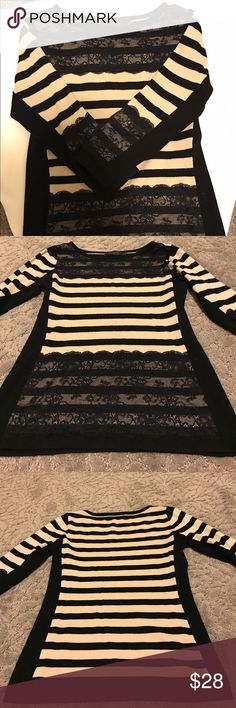 The Limited// Women's Sweater Black and Tan striped top. Lace detail in the front by the neckline and by the bottom of the top. Lace is also by the end of the sleeves. The length of the sleeve is 3/4. Made out of Rayon and Nylon. The lace is nylon and spandex. Gently worn. Not a tight fit. The Limited Tops