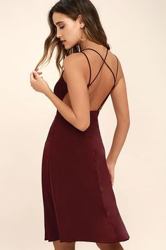 The Ambiance Wine Red Midi Dress is here to set the mood for a great night! Silky, woven fabric flows from adjustable, crisscrossing spaghetti straps into a triangle bodice. Full, midi skirt sways below a banded waist. Hidden back zipper/clasp.