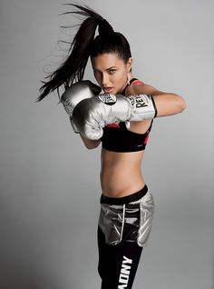 """Girls Keep Swinging - Though it's now almost commonplace to see supermodels duking it out in old-school boxing gyms, Adriana Lima was one of the first to throw a punch. """"Ihate machines, soI started more than ten years ago—before the revolution,"""" she says, laughing.  Fashion Editor: Tonne Goodman"""