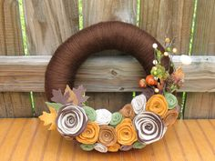 Chocolate Pumpkin Patch Wreath- Fall Wreath--Autumn Wreath--Thanksgiving Wreath-Fall Decoration- Fall Pumpkin Decor- Felt Flower Yarn Wreath. $36.00, via Etsy.