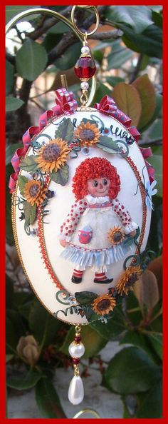 Raggedy Ann and Sunflowers, goose egg, paper tole, floral punch art, eggart