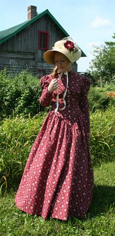 Victorian style. Like the bonnet too! Wish I could find a pattern for a dress like this...