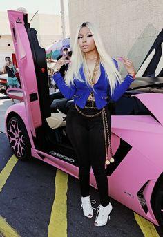 Nicki Manaj standing by her amazing car!!!!!