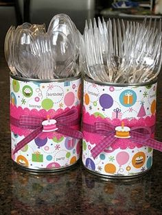 Good use for clean soup cans. Use paper that matches the invitation and decorations or buy a few sheets of scrapbooking paper in a graduation theme.