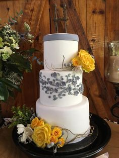 Grey and yellow wedding cake floral vine and willow