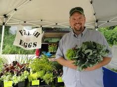 It's me, holding leaf lettuce and kale! This was taken in 2011 at the West View Farmers' Market.