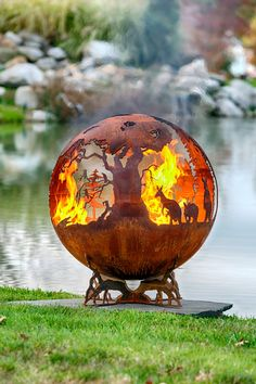 This Australian themed fire pit and features kangaroos, kookaburra birds, a crocodile and a small koala bear. The globe shaped sphere sits