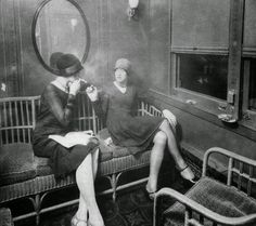 vintage everyday: Flappers smoking cigarettes in a train car, ca. 1920s