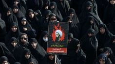 An Iranian woman holds up a poster showing Sheikh Nimr al-Nimr, a prominent opposition Saudi Shiite cleric who was executed last week by Saudi Arabia.  Monday, Jan. 4, 2016: A number of Saudi Arabia's allies have joined diplomatic action against Iran after the Saudi embassy in Tehran was attacked amid a row over the execution. Bahrain and Sudan have both severed relations with Iran, and the UAE has downgraded its diplomatic team. Saudi Arabia on Sunday severed ties with Iran.