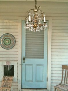 We added a chandelier, vintage door and wood moulding to add character.  A ceiling medallion I painted years ago hangs above the chicken door.