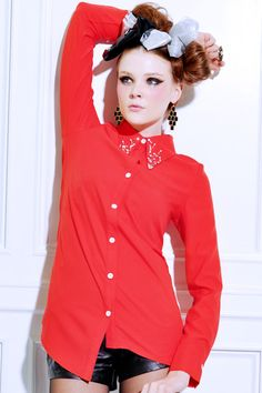 Beads Collar Assymetric Red Shirt. Description Red shirt,featuring a lapel with white and faceted beads embellishment,long sleeve style design with two buttons close up,a white button line front,dropped hem with asymmetric detailing finish. Fabric Polyester Washing Cool hand wash #Romwe
