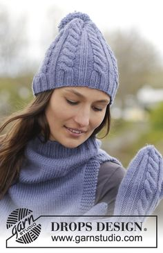 """Aline - Set consists of: Knitted DROPS hat, mittens and neck warmer with cables and pompom in """"Nepal"""". - Free pattern by DROPS Design"""