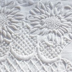 Whitework Embroidery 101: From Stitches to Patterns -- great article full of good information.  I love the look of white on white, so clean and crisp.