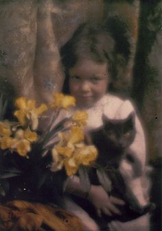 Edward Steichen, autochrome photo, 1910's  Girl with a black cat and daffodils