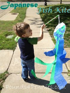Fun and easy toddler craft on How to Make a Japenese Flying Kite. Enjoy this craft for kids of any age. This was a fun craft to make with my toddler. Includes fish printable to make your own.