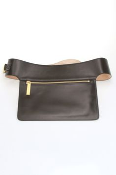 Flat Pocket Belt in Black Michael Kors founded his namesake line in 1981. Famous for producing polished, sleek, sophisticated American sportswear with a jet-set attitude, his coveted collection includes a range of beautiful purses, lust-worthy shoes and many other must-have accessories; Features push-release buckle closure; Gold toned logo embossed hardware; Flat pocket with zipper closure; Suede backing BeltWomen #Bags #Accessories