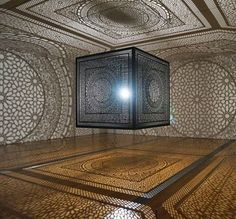 cubebreaker:  Anila Quayyum Agha's Intersections uses a 6.5ft laser-cut wooden cube to cast amazing shadow patterns on the room which holds it, all with just a single light bulb.