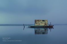 Winter Boat - Pinned by Mak Khalaf A photo of covered boat like a room in lake El-Burullus in order to protect fishermen from rains in winter season .. Fine Art beautifulblueboatcalmcharmingd5100egyptlakelonelynikonroomtravelwaterweatherwinter by sterptococcus778