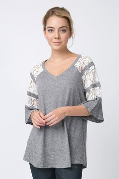 Heather grey casual top with lace, bell sleeves and a v neckline.