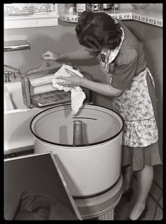 """Through the Wringer"" (1942) • ""To keep your wringer operating properly, dry rolls thoroughly after use with a soft cloth and then release lever which removes pressure from the rolls."" • by Dave • Photo: Ann Rosener for the Office of Emergency Management"