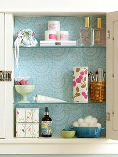Add decorative paper to the inside of a medicine cabinet. Love this idea! bhg