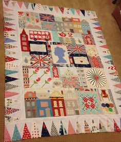 UK-themed quilt ~ with the queen's silhouette center, double-decker bus, London landmarks, Union Jack, etc.