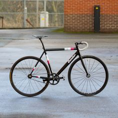 """Stylish black bike frame, with curves and clear typography.  """"Condor"""""""