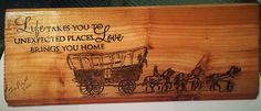 Covered wagon house sign