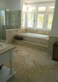 Coral stone master bathroom- make a step ledge for our whirlpool tub?