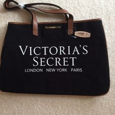 VICTORIA'S SECRET TOTE BAG❤️. NWT Victoria's Secret tote bag.  New with tags.  Black canvas with brown faux leather handles.  Black and pink stripes on bottom and sides of bag.  No zip or snap closures.  Measures 17.5 wide,  11.5 high.  Great Christmas gift to give or keep!!! Victoria's Secret Bags Totes