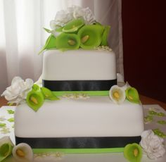 Lime Green and Black Wedding Cake - Lime green/Black ribbone with MMF, edible flowers from 50/50 roses, calla lilies and blossoms.