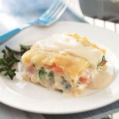 Vegetarian Lasagna Alfredo Recipe -A dry alfredo mix is what hurries along the preparation of this tasty pasta casserole. It's family-pleasing with lots of sauce and veggies.—JamieLynn Griffith, Buffalo, New York