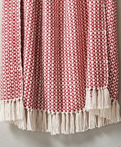 Come home to the traditional warmth of a neutral checkered weave and tasseled trim. Crafted from an acrylic/cotton blend for outstanding softness and durability, the Checkered Fringe Throw is accented with a wide, natural tassel trim.