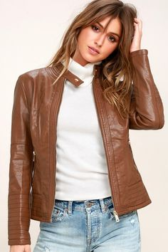 The New Bae Brown Vegan Leather Moto Jacket is sure to be your new fave! Super soft, brown vegan leather shapes this unique moto jacket with a collarless silhouette and snap neckline. Shiny gold front zipper, side pockets, and long sleeves with quilted cuffs complete the look.