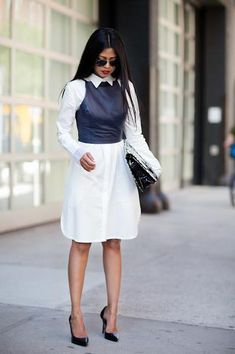 chic schoolgirl outfit ideas - cropped leather halter top worn over a long white shirt dress with classic black pointy-toe heels and a clutch // walk in wonderland