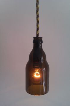 Honey, honey - reused beer bottle pendant light. €47,00, via Etsy.