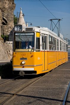 Gellért Hill Tram ― If you don't walk take one of the following trams ~ № 18, № 19/41, № 47, or № 49. You need to buy your ticket in advance and vaildate it onboard at the start of your journey. You either find red punch-machines or orange automated machines on the tram. #Budapest #Tram #GellertHill